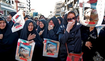 Iranian women hold images of one of the victims Mohammad Taha Eghdami, 4, during a public funeral ceremony for those killed during an attack on a military parade on the weekend, in the southwestern Iranian city of Ahvaz on September 24, 2018