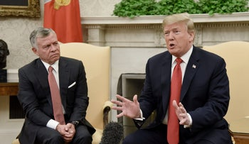 U.S. President Donald Trump, right, speaks as King Abdullah II of Jordan, listens during a meeting in the Oval Office of the White House in Washington, D.C., U.S., on, June 25, 2018.
