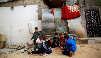 Palestinians children play outside a house in the al-Shati refugee camp, Gaza City, January 4, 2018.