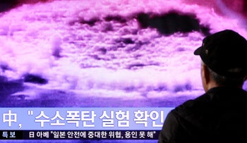 A man watches a television screen showing a news broadcast on North Korea's nuclear test at Seoul Station in Seoul, South Korea, on Wednesday, Jan. 6, 2015. North Korea said it successfully tested its first hydrogen bomb, the fourth time it has detonated a nuclear device.