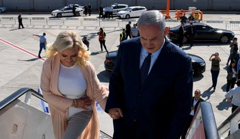 Prime Minister Benjamin Netanyahu boards a plane on his way to New York to attend the United Nations General Assembly with his wife Sara, Tuesday, September 25, 2018