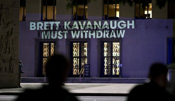 """The words """"Brett Kavanaugh Must Withdraw"""" are projected by demonstrators onto the E. Barrett Prettyman United States Courthouse in Washington, D.C., U.S., on  Sept. 25, 2018."""