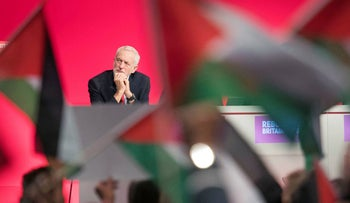 Britain's Labour leader Jeremy Corbyn sits on stage, during the Labour Party's annual conference at the Arena and Convention Centre (ACC), in Liverpool, England, Tuesday Sept. 25, 2018. (Stefan Rousseau/PA via AP)