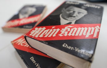 """Copies of the 2015 German edition of """"Mein Kampf,"""" a heavily annotated version that highlighted the propaganda and factual errors in the original."""