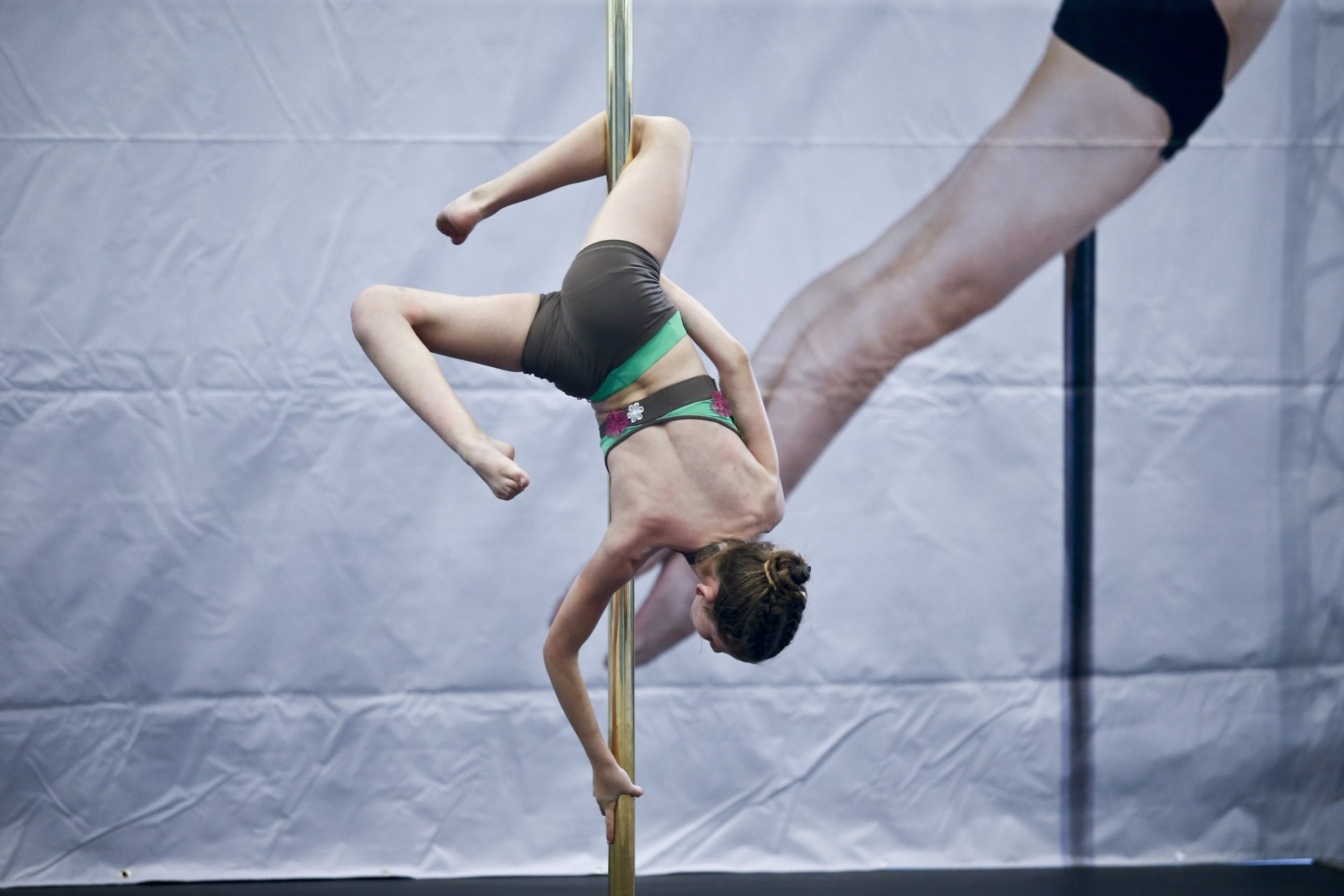My daughter is flexible, the instructor told me. She'll ruffle in the air like a flag atop a pole.