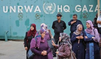 Palestinian employees of United Nations Relief and Works Agency (UNRWA) take part in a  protest against job cuts by UNRWA, in Gaza City, on September 19, 2018.