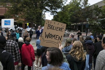 Protesters stand in front of Sen. Susan Collins' office to urge her to vote no on the confirmation of Supreme Court nominee Brett Kavanaugh on September 28, 2018