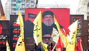 Hezbollah supporters gathering near a giant poster of leader Hassan Nasrallah on September 20, 2018.