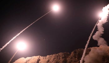 This handout photo provided by Iran's Revolutionary Guard official website via SEPAH News shows missiles being launched from an undisclosed location to target militants in eastern Syria early on October 1, 2018.