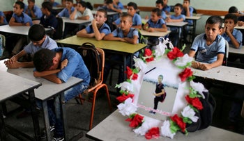 A picture of 12-year-old Palestinian boy Nassir al-Mosabeh, killed during a protest at the Israel-Gaza border fence, on his school desk in Khan Younis, southern Gaza Strip. September 30, 2018.