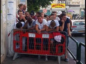Asylum seekers outside the offices of the Israeli interior ministry in Tel Aviv.