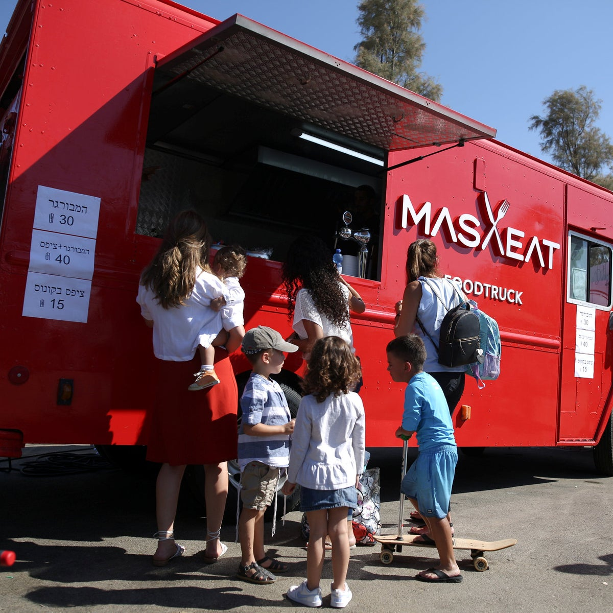 The MasaEAT food truck in Ashdod. Once a FedEx vehicle, now delivering hamburgers all around Israel.