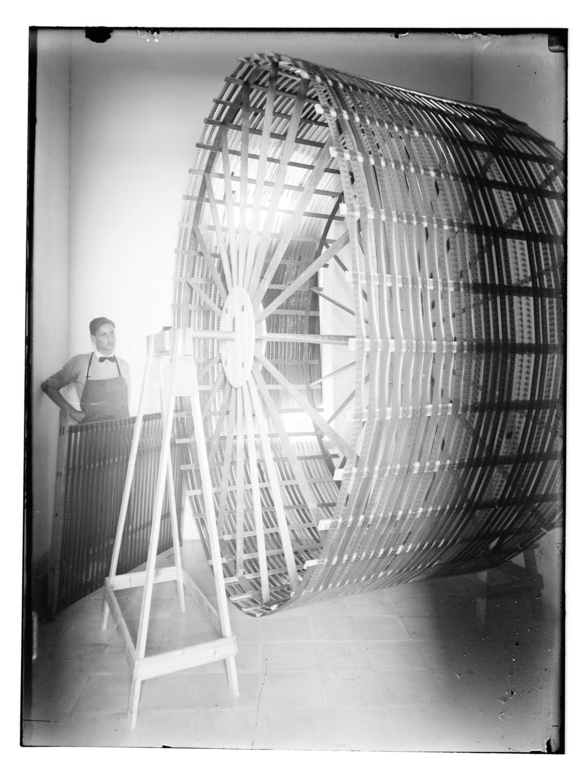 Jamil Albina with a film dryer at the American Colony, Jerusalem, 1920-1930.