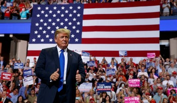 President Donald Trump arrives to speak at a campaign rally at the Landers Centre Arena in Southaven, Miss. Oct. 2, 2018.
