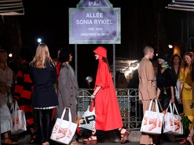 Models holding shopping bags at the end of the Sonia Rykiel Spring-Summer 2019 Ready-to-Wear collection fashion show in Paris, on September 29, 2018.