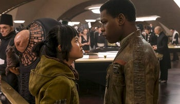 """This image released by Lucasfilm shows Kelly Marie Tran, left, and John Boyega in """"Star Wars: The Last Jedi."""""""