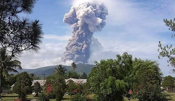 This handout picture taken and released on October 3, 2018 by Indonesia's National Agency for Disaster Management (BNPB) shows Soputan volcano erupting ash up to 4,000 metres above the crater, as seen from Pinabetengan in Southeast Minahasa, North Sulawesi Province