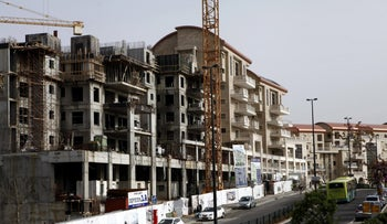 New residential apartment blocks stand during construction in Jerusalem.