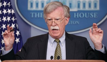 Bolton answers a question from a reporter about how he refers to Palestine during a news conference in the White House, Washington, U.S., October 3, 2018.