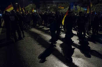 """Members of the right-wing populist """"Pro Chemnitz"""" movement march through the streets of Chemnitz, eastern Germany. September 7, 2018"""