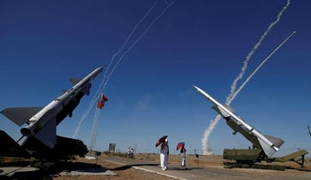 People watch S-300 air defense missile systems launching missiles during the Keys to the Sky competition at the International Army Games 2017 at the Ashuluk shooting range outside Astrakhan, Russia, August 5, 2017. REUTERS/Maxim Shemetov/File Photo