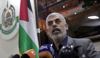 Yahya Sinwar, the leader of Hamas in the Gaza Strip, speaks to foreign correspondents in his office in Gaza City, May 10, 2018.