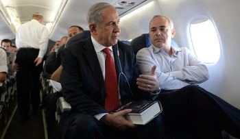 Netanyahu departing for Poland, holding a copy of The Last Lion, a collection of biographies chronicling the life of Winston Churchill