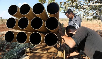 Syrian rebel fighters prepare their heavy artillery in the Syrian village in the northern countryside of Hama on September 17, 2018.