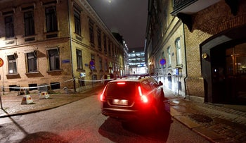 Police at the site of the firebomb attack near a synagogue in Gothenburg, Sweden. December 9, 2017