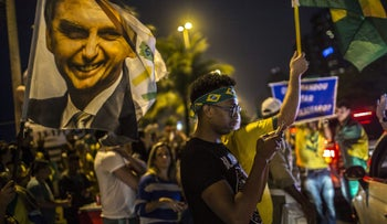 Supporters of Jair Bolsonaro, presidential candidate for the Social Liberal Party (PSL), celebrate after polls closed during the first round of presidential elections in Rio de Janeiro, Brazil, on Oct. 7, 2018.