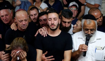 Husband of Kim Yehezkel-Levengrond at her funeral, October 7, 2018.