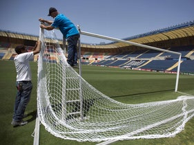 File photo: Changing the net at Jerusalem's Teddy Stadium in preparation for the European Championship's youth league, 2013.