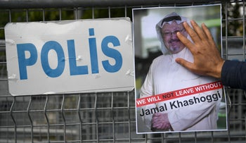 A protestor holds a picture of missing journalist Jamal Khashoggi during a demonstration in front of the Saudi Arabian consulate, on October 5, 2018 in Istanbul