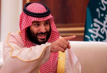 Saudi Crown Prince Mohammad bin Salman gestures during his meeting with the Emir of Kuwait at the Bayan Palace in Kuwait City. September 30, 2018