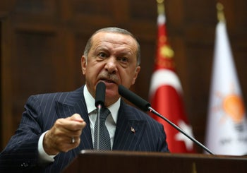 Turkish President and leader of Turkey's ruling AKP, Recep Tayyip Erdogan, addresses the crowd at the Grand National Assembly of Turkey in Ankara. October 02, 2018