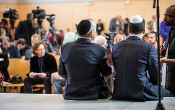 Two men waiting for the start of a press conference as part of the launch of Jews in the AfD, in Wiesbaden, Germany, October 7, 2018.