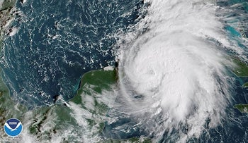Tropical Storm Michael is seen in the Gulf of Mexico in this NOAA GOES-East satellite image taken October 8, 2018.  Courtesy NOAA GOES-East/Handout via REUTERS