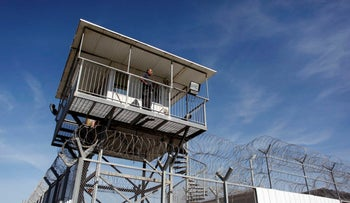 FILE Photo: An Israeli prison guard keeps watch from a tower at Ayalon prison in Ramle near Tel Aviv.