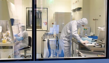 FILE Photo: Medical researchers work on a new form of personalized cell therapy against cancer with highly specialized technology in Leipzig, Germany.
