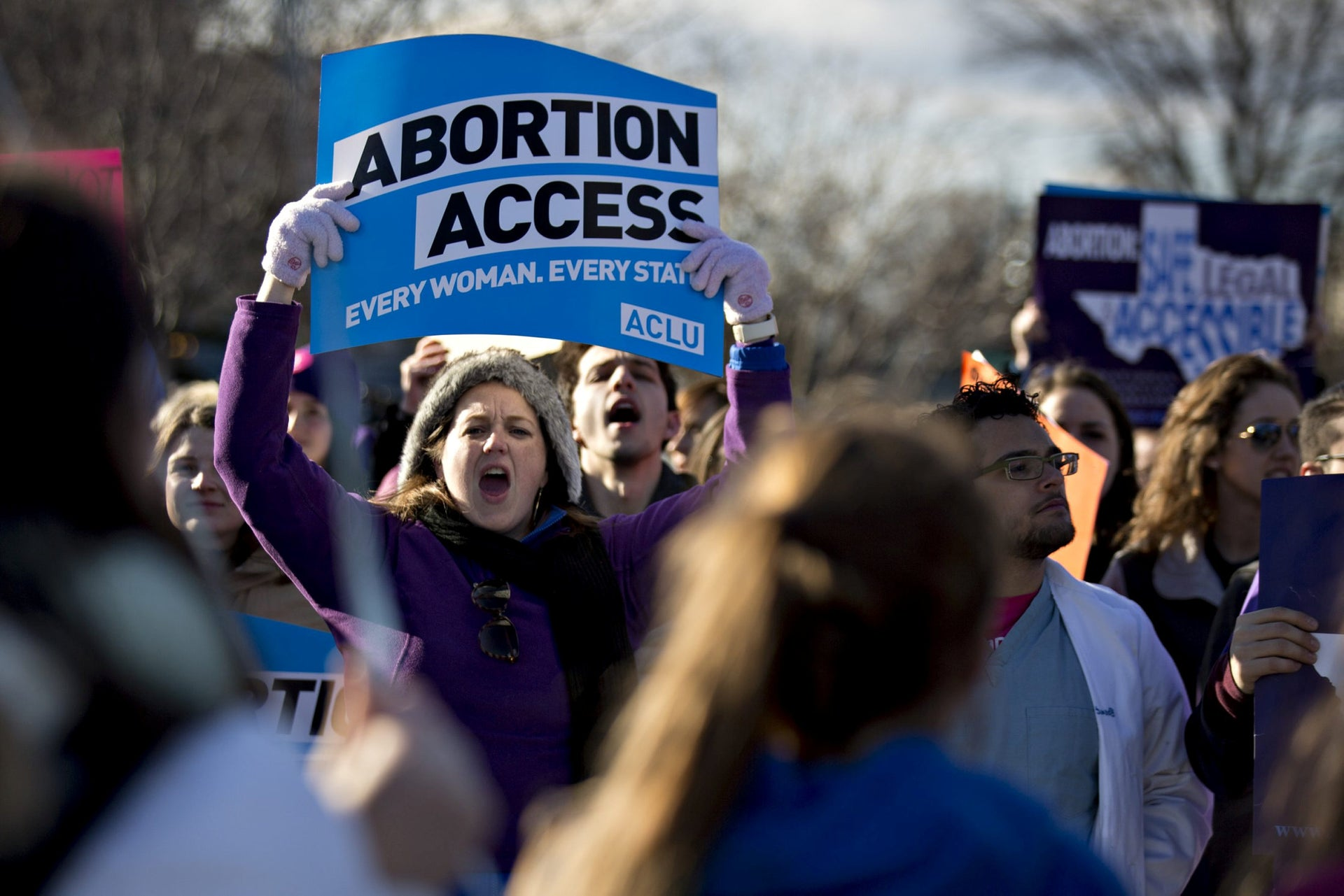 A demonstrators holding up a sign in support of pro-choice rights outside the U.S. Supreme Court in Washington, March 2, 2016.
