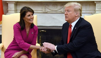 U.S. President Donald Trump shakes hands with Nikki Haley, the United States Ambassador to the United Nations  in the Oval office of the White House on October 9, 2018.