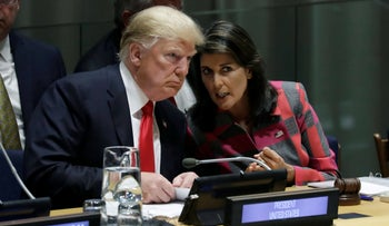 President Donald Trump talks to Nikki Haley, the U.S. Ambassador to the United Nations, at the United Nations General Assembly on September 24, 2018.