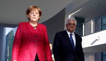 German Chancellor Angela Merkel and Palestinian President Mahmoud Abbas attending a joint news conference in Berlin, 2011.