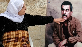 Farida Daka caresses a photo of her son Walid. Next week is the start of his 29th year in prison for kidnap and murder.