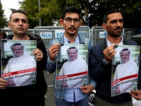 Members of the Turkish-Arab journalist association hold posters with photos of missing Saudi writer Jamal Khashoggi, as they hold a protest near the Saudi Arabia consulate in Istanbul, on October 8, 2018.