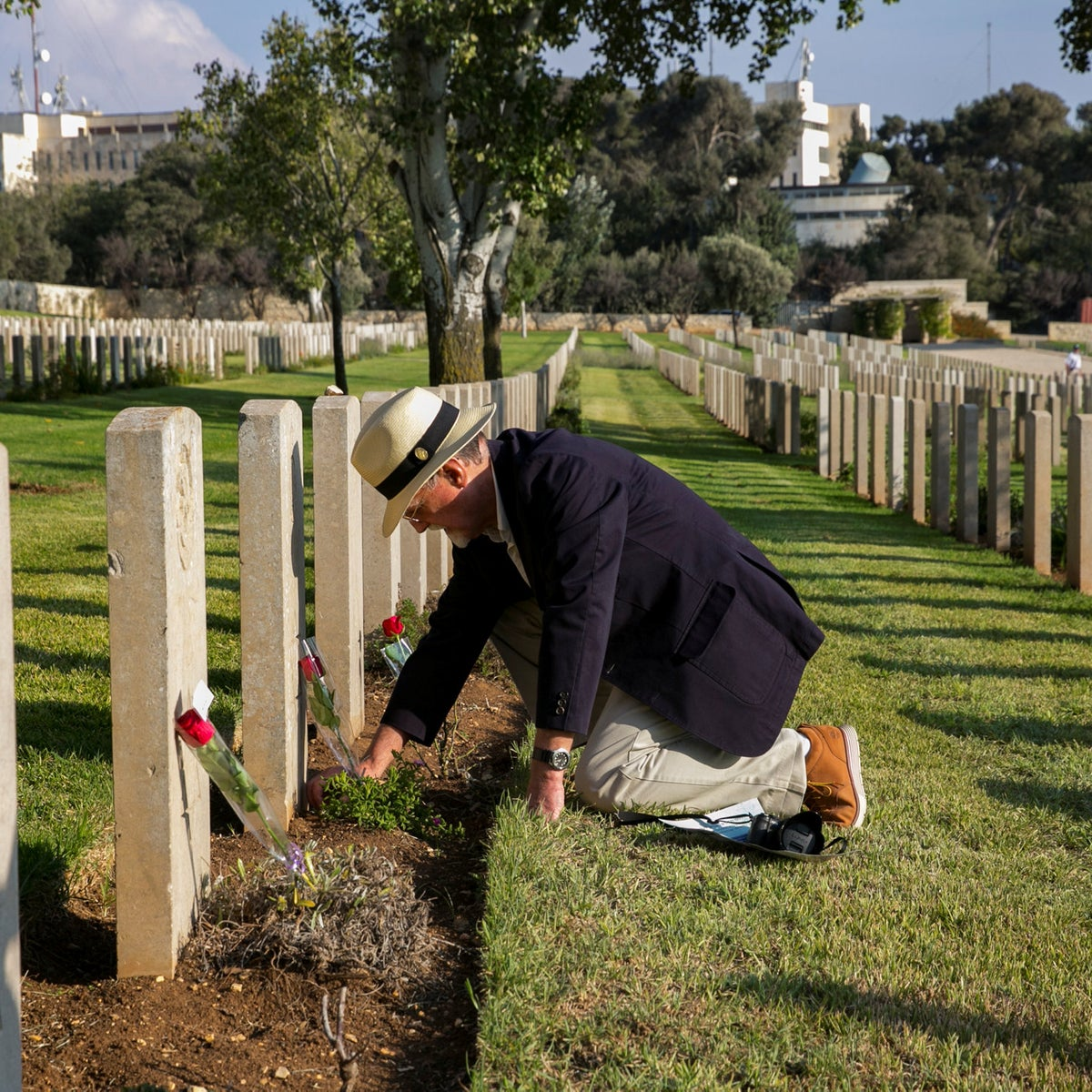 A man laying flowers at the grave of a member of the Jewish Legion who died during World War I, Mount Scopus, Jerusalem, October 10, 2018.