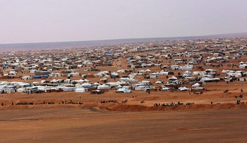 This file picture taken Tuesday, Feb. 14, 2017, shows an overview of the informal Rukban camp, between the Jordan and Syria borders