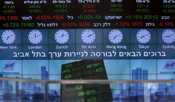 A stock market ticker displays financial information and world time zones in the lobby of the Tel Aviv Stock Exchange (TASE) in Tel Aviv, Israel, on August 4, 2016.