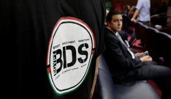 An Egyptian wearing a T-shirt with a logo of BDS, April 20, 2015 (illustrative).