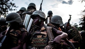 Soldiers from the Armed Forces of the Democratic republic of the Congo are seen gearing up as gunfire erupts close by, Oicha, October 07, 2018.
